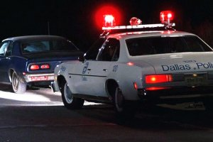 Dallas police car is parked behind a pulled-over car