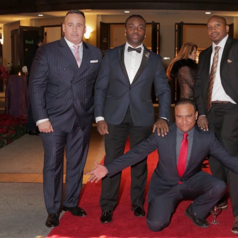 Members of the NYPD12 pose on the red carpet at the IDA Awards.