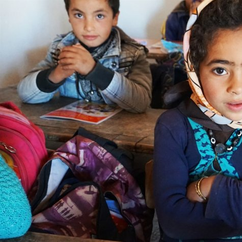 A group of Indigenous Moroccan school children sit at their desks in a classroom. From Mohamed El Boudi's 'School of Hope', courtesy of Hot Docs.
