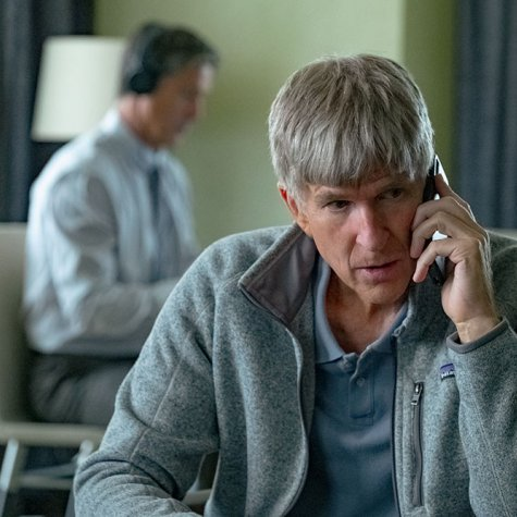 Actor Matthew Modine portrays William 'Rick' Singer, a white man in a grey-striped polo shirt, in 'Operation Varsity Blues,' a docudrama that was publicized as a documentary. Modine has grey hair and is talking on a cellphone while sitting. Courtesy of Netflix
