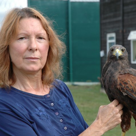A middle-aged woman with an eagle