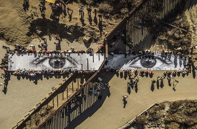 A birds eye view of a large mural of two eyes.