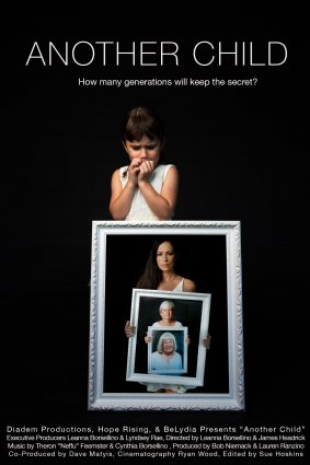 A child is holding a frame within a frame.
