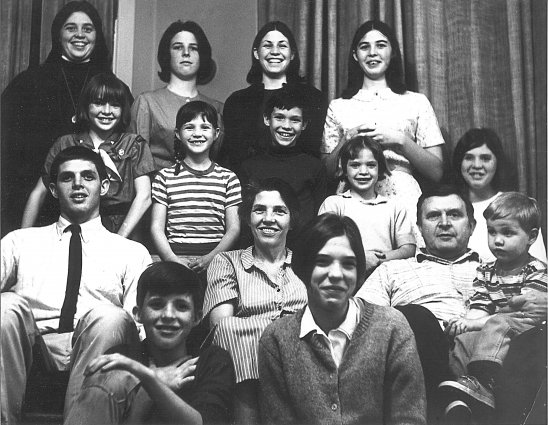 large family poses for black and white picture