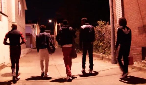 group of LGBTQ+ gang members walk down alley at night