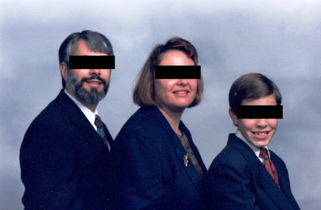 white couple with young son pose for family portrait with their eyes covered by black censor bars