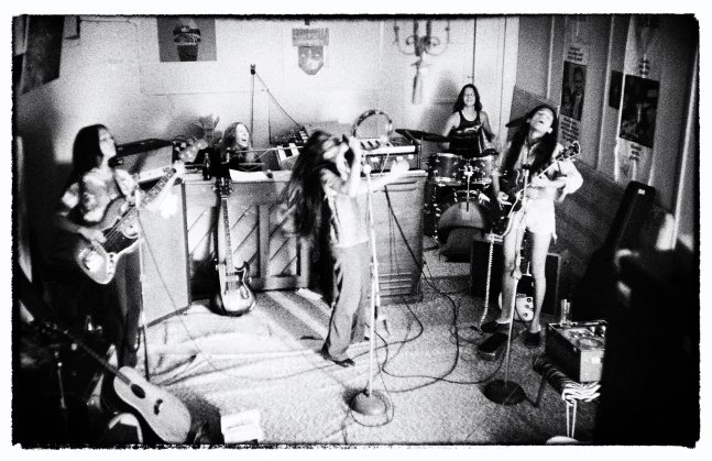 """Black and white photograph of a studio performance of the rock group """"Fanny"""""""