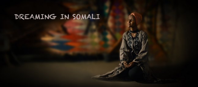 A female Somalian is sitting on the ground.