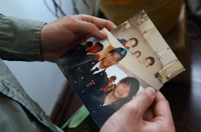 photo of hands holding image of a victim of hazing
