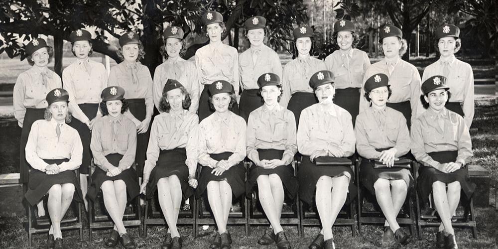 A large seated portrait of 18 WWII-era female military nurses