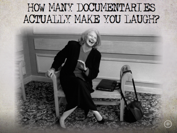 Molly Ivins laughs on a bench in business attire