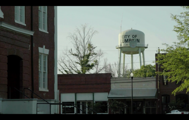 The city of Lumpkin Water Tower looms over the empty Old Town streets
