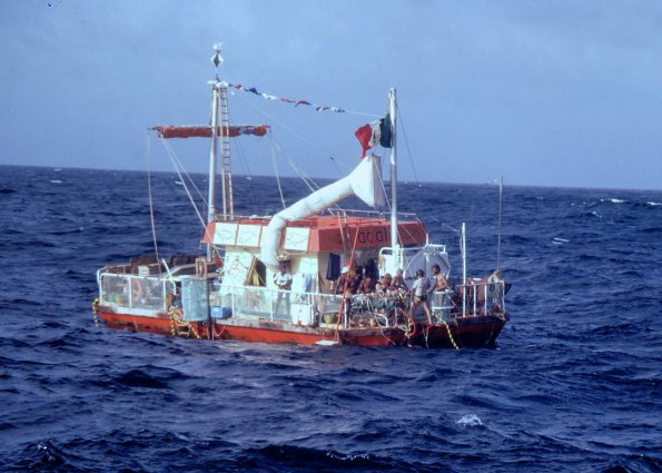 The Alcali Vessel at sea with the crew on deck.