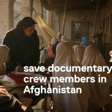 film still from 'Angels are Made of Light' of Afghan girls in school session in a courtyard.