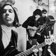 Three members of the Velvet Underground rehearsing in the studio. All are playing guitars. From Todd Haynes' 'The Velvet Underground.' Courtesy of Apple TV.