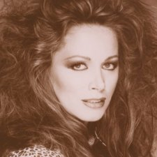 A sepia portrait of Jackie Collins, a white woman with permed hair and a leopard print blouse. Still from 'LADY BOSS: The Jackie Collins Story' (Directed by Laura Fairrie, Produced by John Battsek, Lizzie Gillett) Courtesy of Tribeca Film Festival