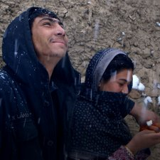 A young Afghan couple pictured in the snow. Image from Elizabeth and Gulistan Mirzaei's 'Three Songs for Benazir,' which is set and filmed in refugee camps in Afghanistan. Courtesy of the filmmakers.