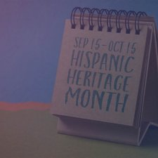 Notebook with the text Sep 15-Oct 15 Hispanic Heritage Month written in black text.