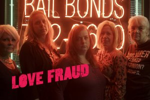 A group of middle-aged women standing in front of a bail bonds neon sign