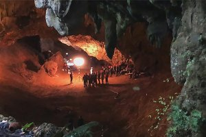 A group of people inside a dark cave.