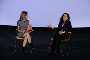 Caty Borum Chattoo (left) and Sally Jo Fifer (right) sitting on orange chairs next to each other.