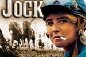 """""""Jock"""" Documentary Film Poster. A sepia-toned image of jockey's racing horses with a color image in front of a young girl smoking a cigarette and wearing a jockey's helmet."""