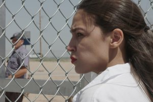 AOC looks through chainlink fence of detention center