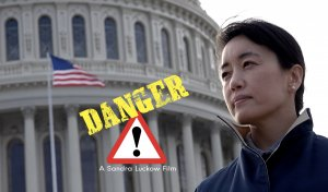 An Asian woman in a windcoat stands in front of the US Capitol.