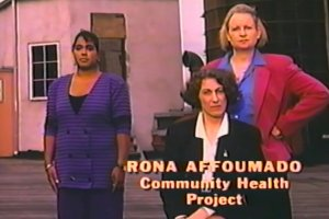 Rona Affoumado stands in front of fellow Community Health Project workers