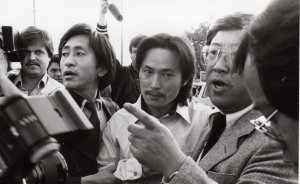 Black and white photo of Chol Soo Lee being taken into police custody.