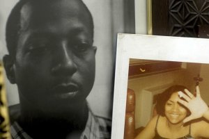 "A still from ""For Venida, For Kalief"": Two framed photos sit on a bedside cabinet, one of Kalief Browder, a young Black man wearing a checked shirt, and the other of a young Black woman wearing a sleeveless black top."
