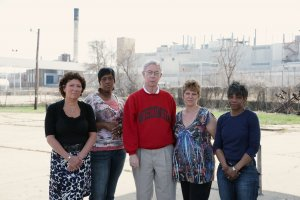 former factory employees posed outside of warehouse in Wisconsin