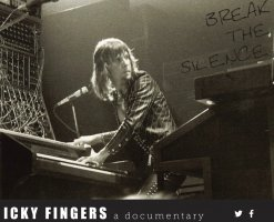 Keith Emerson is playing the piano during a concert.