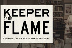 An office crowded with files and books with a white square over the office containing the title and subtitle: Keeper of the Flame, A documentary on the life and work of Jack Healey.