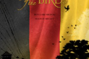 """""""Jealous of the Birds"""" Film poster. This poster has a vertical German Flag (Black, Red and Gold) as the backdrop. In front of the flag is a silhouetted tree with two figures standing at its base."""
