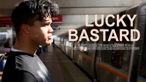 A young boy stands before an arriving subway train.