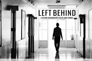 A silhouetted student walks through the hallways of this public high school.