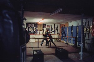 Mariah boxes with her male coach in an empty boxing gym