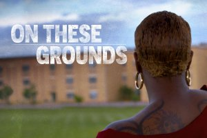 A student looks at her high school building from a distance, title treatment reads ON THESE GROUNDS.
