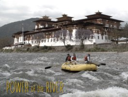 a yellow raft floats down the rapids of a Bhutanese river with a large building on the distant shore.