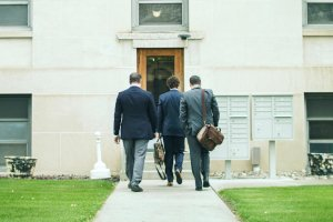 Jensen Civil Case Lawyers (L-R) Dan Rice, John Heenan, and Bryant Martin entering the Custer County Court House in Miles City, Montana.