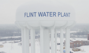 A photo of a water tank labeled 'Flint Water Plant' in the winter.