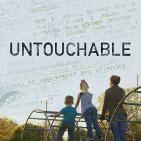 """The gritty, textured film title """"UNTOUCHABLE"""" appears over a blue sky superimposed with court documents detailing pedophilia. Two children play with their mother on a structure below this ominous sky."""
